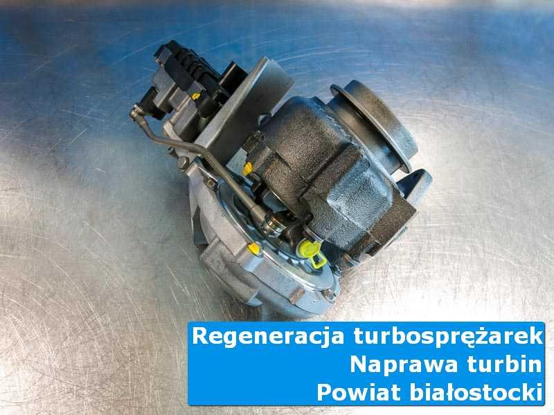 Turbosprężarka przed wysyłką na stole w pracowni, powiat białostocki