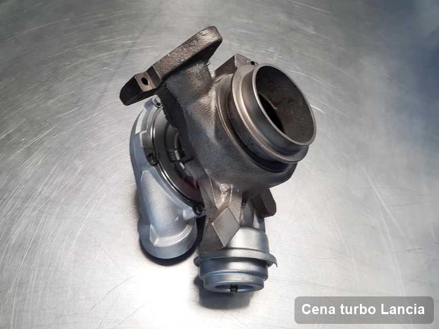 Turbina do auta z logo Lancia po remoncie w pracowni gdzie zleca się usługę Cena turbo