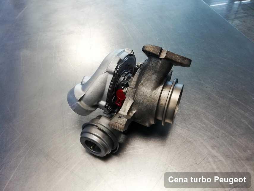 Turbosprężarka do samochodu osobowego z logo Peugeot naprawiona w firmie gdzie przeprowadza się  usługę Cena turbo