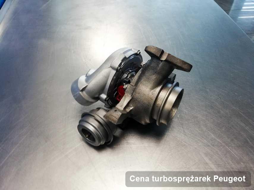 Turbina do samochodu osobowego sygnowane logiem Peugeot po naprawie w laboratorium gdzie przeprowadza się  usługę Cena turbosprężarek