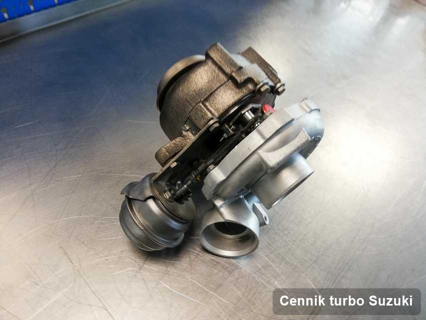 Turbosprężarka do pojazdu sygnowane logiem Suzuki naprawiona w pracowni gdzie przeprowadza się  usługę Cennik turbo