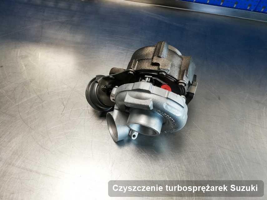Turbina do samochodu sygnowane logiem Suzuki naprawiona w firmie gdzie zleca się usługę Czyszczenie turbosprężarek
