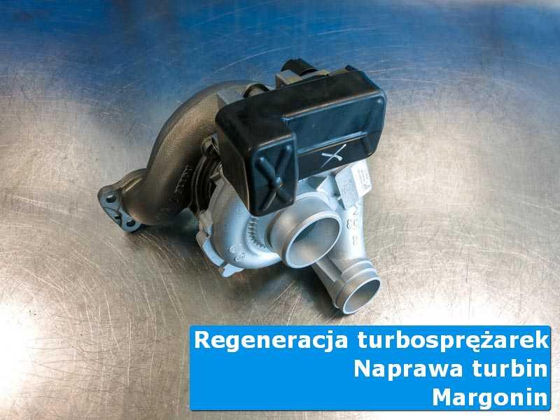 Układ turbodoładowania przed wymianą na stole w laboratorium w Margoninie
