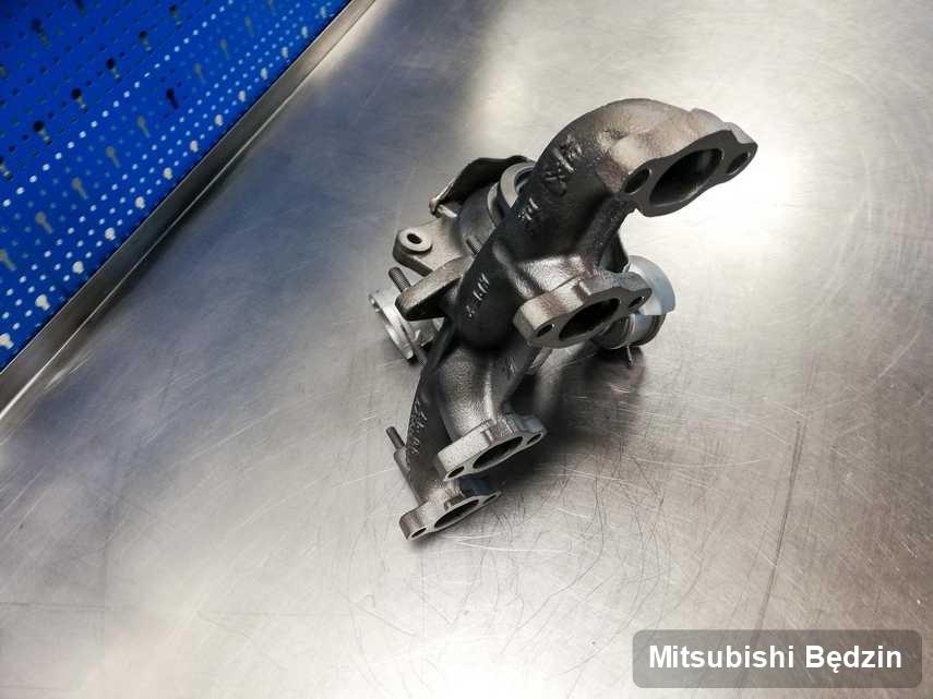 Wyremontowana w firmie zajmującej się regeneracją w Będzinie turbina do osobówki z logo Mitsubishi przyszykowana w warsztacie po naprawie przed spakowaniem