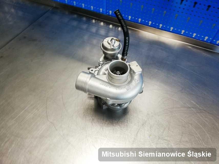 Naprawiona w pracowni w Siemianowicach Śląskich turbosprężarka do pojazdu producenta Mitsubishi na stole w warsztacie po naprawie przed nadaniem
