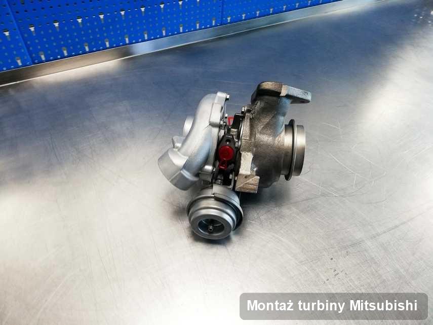 Turbosprężarka do osobówki sygnowane logiem Mitsubishi zregenerowana w laboratorium gdzie przeprowadza się  usługę Montaż turbiny