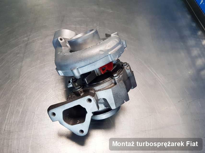 Turbina do pojazdu z logo Fiat po naprawie w przedsiębiorstwie gdzie przeprowadza się  serwis Montaż turbosprężarek