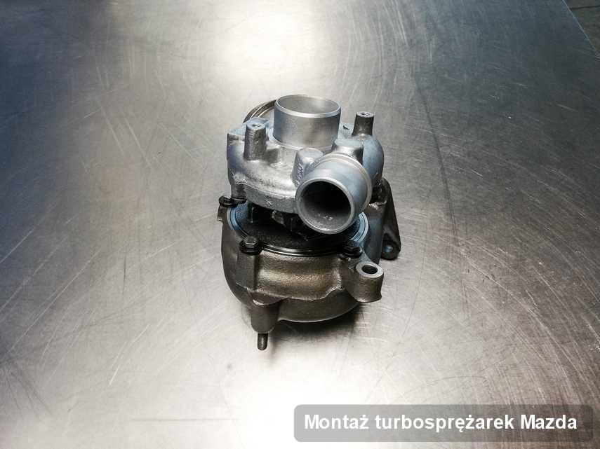 Turbina do auta osobowego spod znaku Mazda po naprawie w przedsiębiorstwie gdzie przeprowadza się  usługę Montaż turbosprężarek