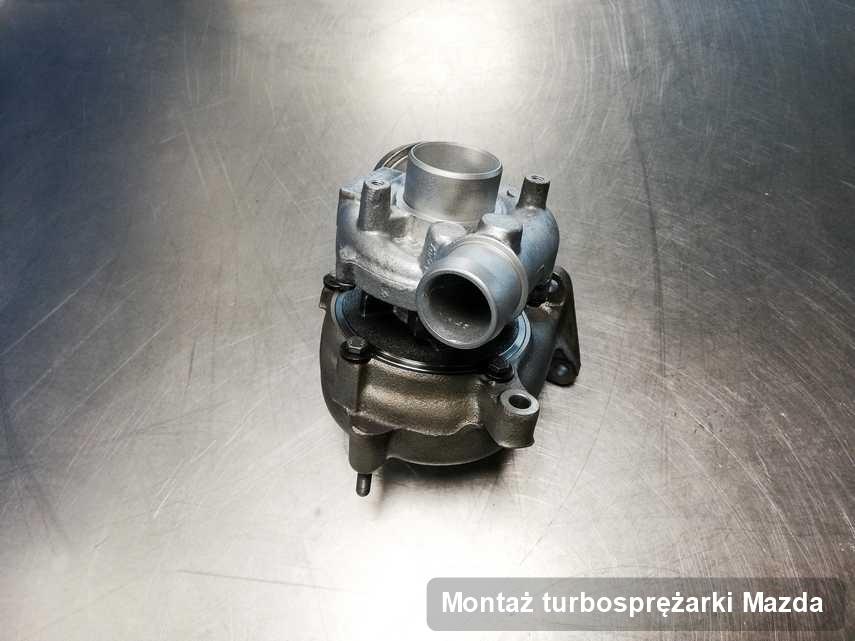 Turbina do samochodu osobowego z logo Mazda wyremontowana w przedsiębiorstwie gdzie wykonuje się serwis Montaż turbosprężarki