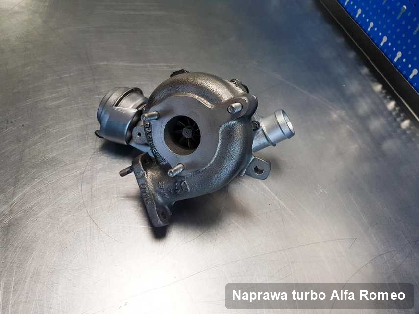 Turbosprężarka do auta osobowego z logo Alfa Romeo wyremontowana w laboratorium gdzie zleca się usługę Naprawa turbo