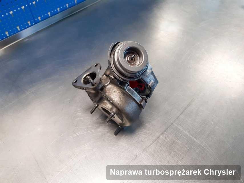 Turbosprężarka do pojazdu firmy Chrysler po remoncie w laboratorium gdzie przeprowadza się  serwis Naprawa turbosprężarek