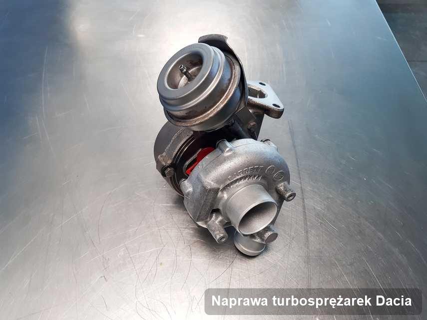 Turbosprężarka do samochodu sygnowane logiem Dacia po naprawie w przedsiębiorstwie gdzie wykonuje się usługę Naprawa turbosprężarek