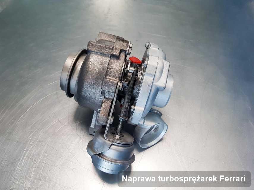 Turbina do samochodu z logo Ferrari zregenerowana w warsztacie gdzie realizuje się usługę Naprawa turbosprężarek