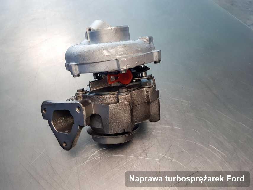 Turbosprężarka do samochodu osobowego marki Ford zregenerowana w laboratorium gdzie przeprowadza się  usługę Naprawa turbosprężarek