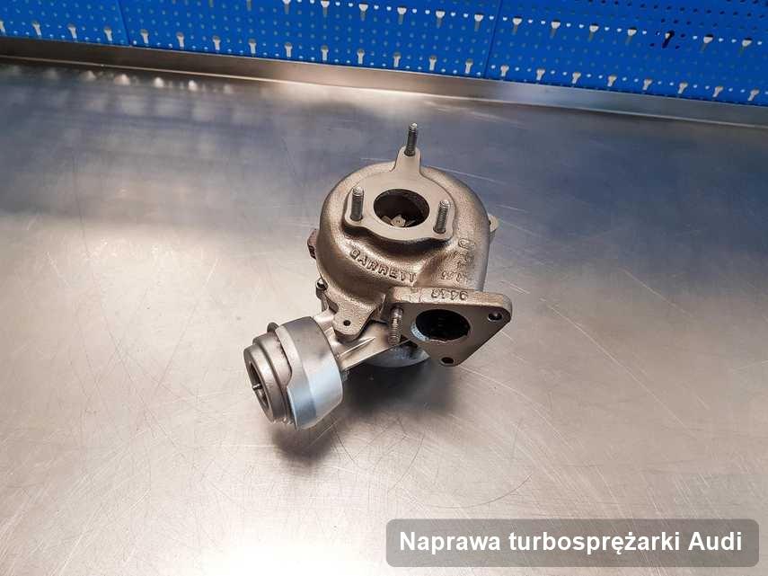 Turbosprężarka do auta z logo Audi zregenerowana w warsztacie gdzie realizuje się serwis Naprawa turbosprężarki