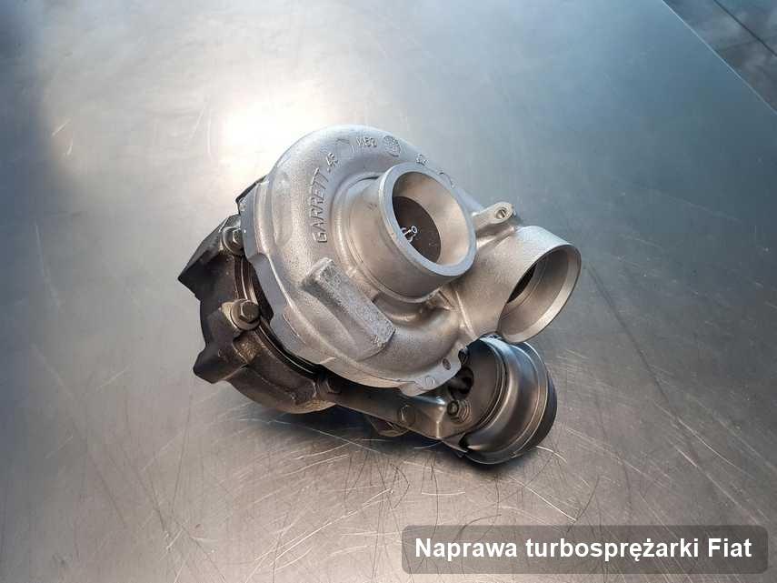 Turbina do samochodu sygnowane logiem Fiat po remoncie w laboratorium gdzie wykonuje się usługę Naprawa turbosprężarki