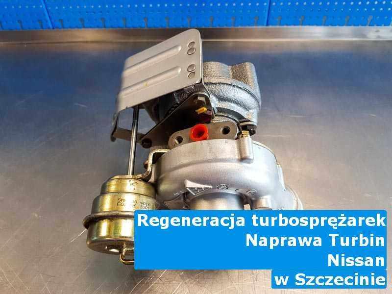 Wyremontowana w firmie w Szczecinie turbosprężarka do osobówki producenta Nissan na stole w pracowni naprawiona przed wysyłką