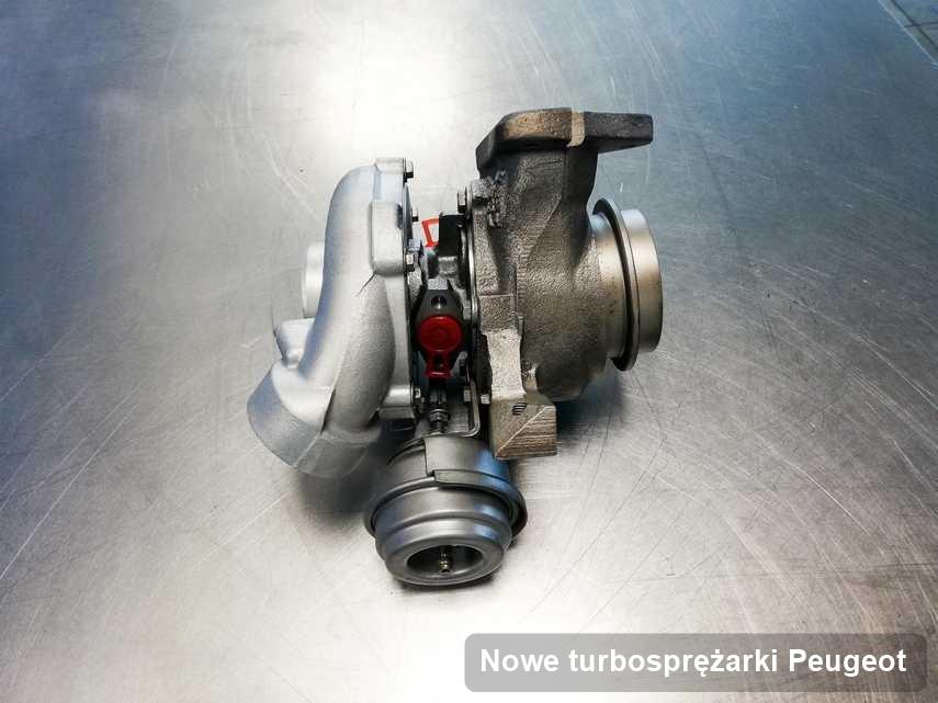 Turbina do samochodu osobowego producenta Peugeot wyczyszczona w laboratorium gdzie przeprowadza się  usługę Nowe turbosprężarki