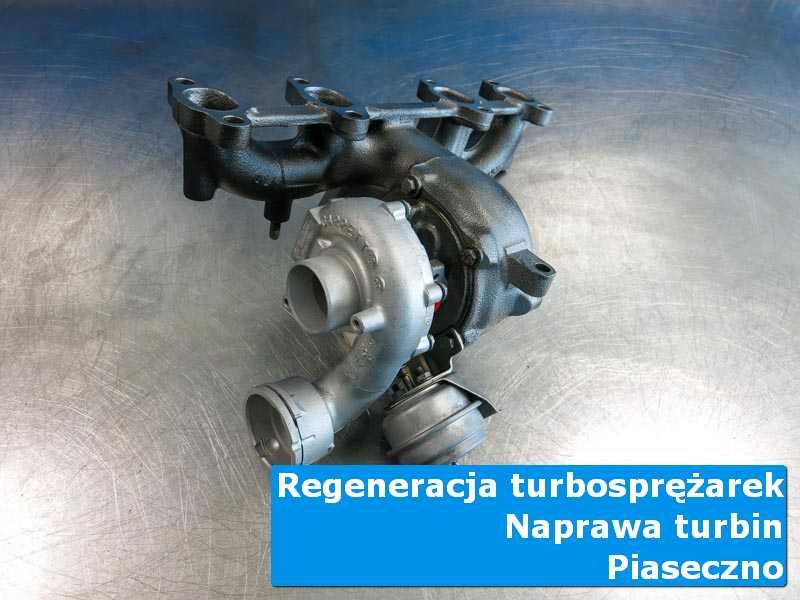 Turbosprężarka przed montażem na stole w laboratorium w Piasecznie
