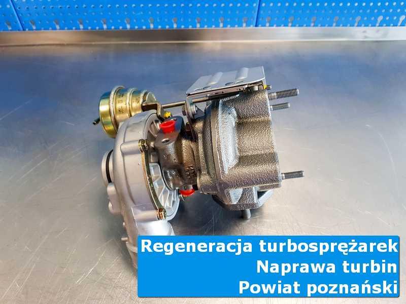 Turbosprężarka po przywróceniu sprawności na stole w pracowni, powiat poznański