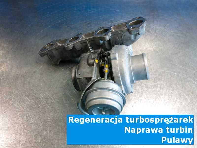 Turbosprężarka przed wymianą na stole pracowniczym z Puław