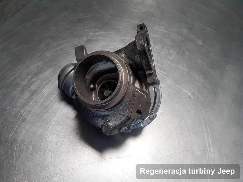 Turbosprężarka do samochodu sygnowane logiem Jeep naprawiona w przedsiębiorstwie gdzie przeprowadza się  serwis Regeneracja turbiny
