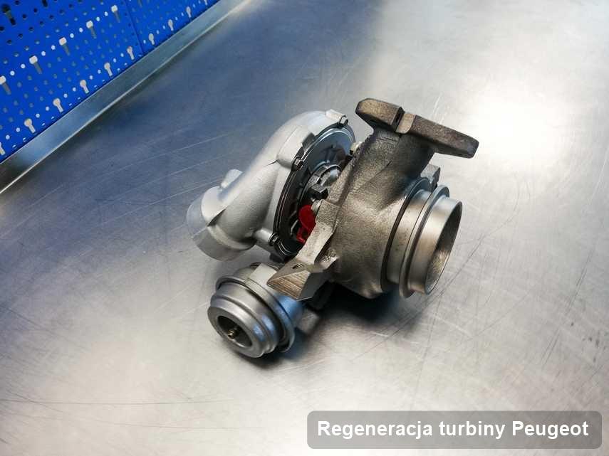 Turbosprężarka do samochodu spod znaku Peugeot wyremontowana w laboratorium gdzie realizuje się usługę Regeneracja turbiny