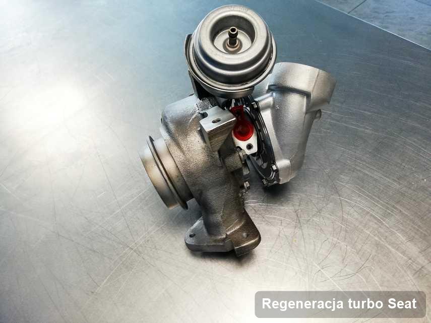 Turbina do osobówki z logo Seat po remoncie w pracowni gdzie realizuje się serwis Regeneracja turbo