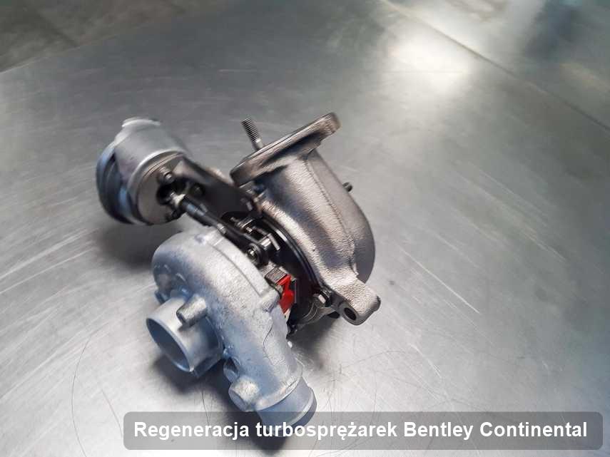 Turbosprężarka do osobówki z logo Bentley Continental po naprawie w firmie gdzie zleca się serwis Regeneracja turbosprężarek