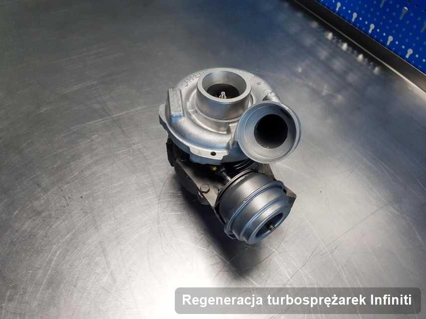 Turbina do auta z logo Infiniti wyczyszczona w laboratorium gdzie zleca się usługę Regeneracja turbosprężarek