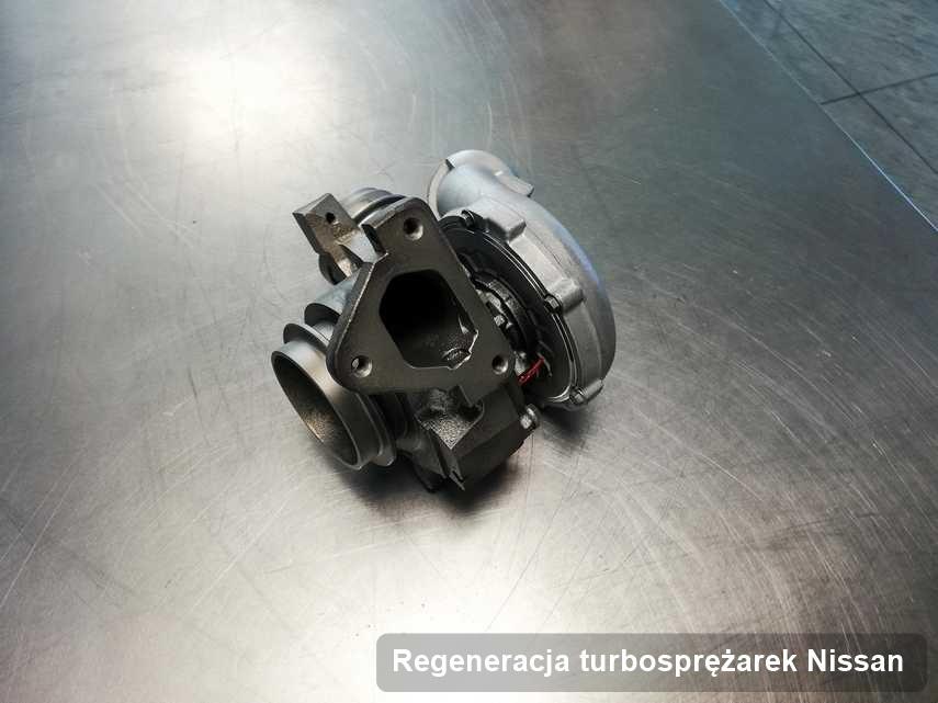 Turbosprężarka do osobówki z logo Nissan po remoncie w firmie gdzie realizuje się usługę Regeneracja turbosprężarek