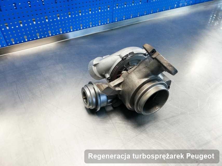 Turbosprężarka do osobówki marki Peugeot wyremontowana w przedsiębiorstwie gdzie wykonuje się usługę Regeneracja turbosprężarek