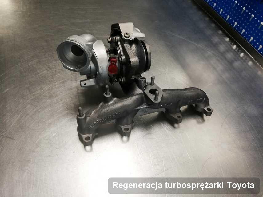 Turbosprężarka do auta osobowego firmy Toyota po remoncie w laboratorium gdzie przeprowadza się  usługę Regeneracja turbosprężarki