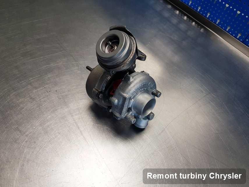 Turbosprężarka do samochodu marki Chrysler po naprawie w warsztacie gdzie realizuje się usługę Remont turbiny
