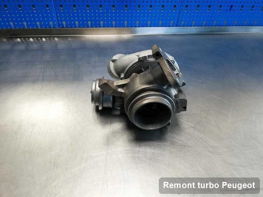 Turbosprężarka do diesla spod znaku Peugeot wyremontowana w laboratorium gdzie wykonuje się usługę Remont turbo