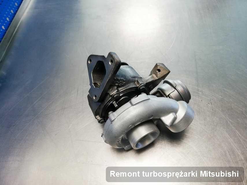 Turbosprężarka do pojazdu sygnowane logiem Mitsubishi po naprawie w laboratorium gdzie zleca się serwis Remont turbosprężarki