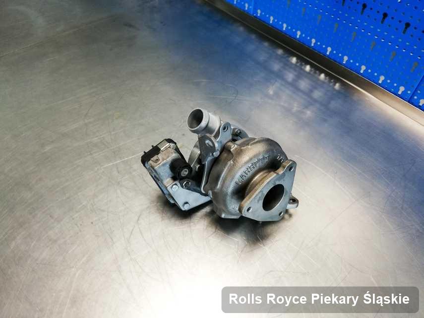 Zregenerowana w firmie w Piekarach Śląskich turbosprężarka do samochodu z logo Rolls Royce przyszykowana w warsztacie wyremontowana przed wysyłką