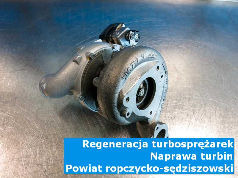 Turbosprężarka po regeneracji na stole pracowniczym, powiat ropczycko-sędziszowski