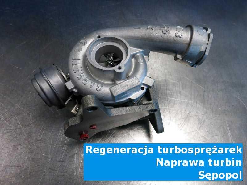 Układ turbodoładowania przed demontażem na stole w laboratorium z Sępopola