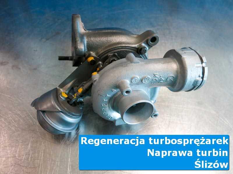 Układ turbodoładowania po demontażu na stole pracowniczym z Ślizowa