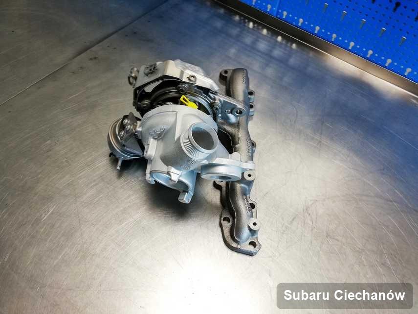Zregenerowana w pracowni regeneracji w Ciechanowie turbina do osobówki producenta Subaru na stole w warsztacie zregenerowana przed wysyłką