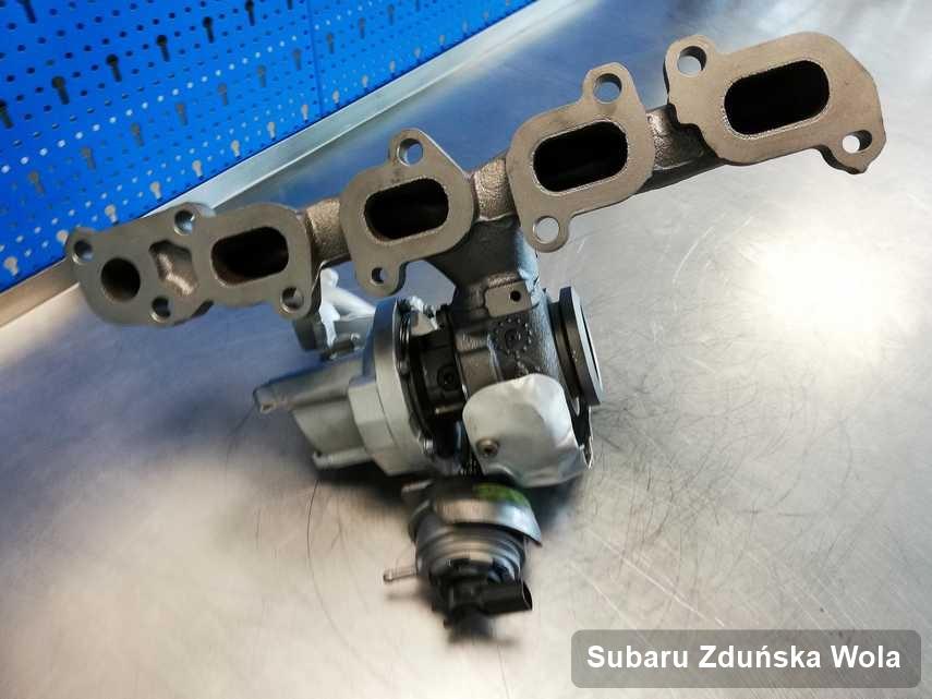 Naprawiona w przedsiębiorstwie w Zduńskiej Woli turbosprężarka do auta producenta Subaru przyszykowana w warsztacie po naprawie przed nadaniem