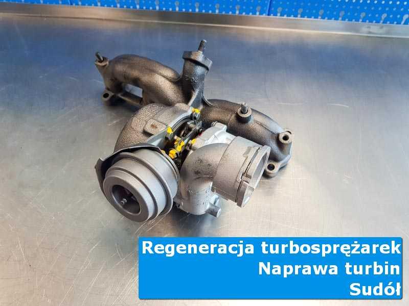 Turbosprężarka przed montażem na stole w pracowni z Sudołu