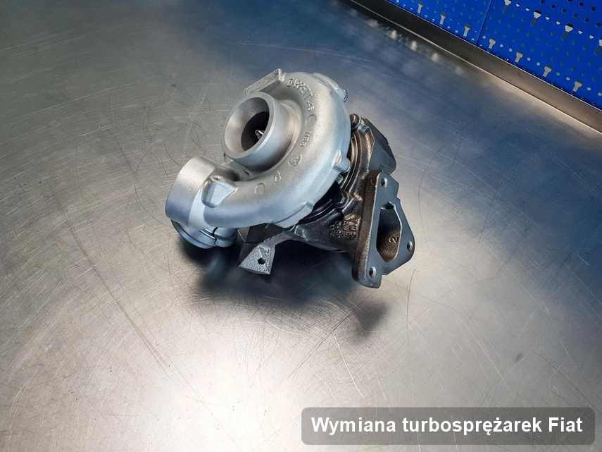 Turbosprężarka do auta z logo Fiat po naprawie w warsztacie gdzie wykonuje się serwis Wymiana turbosprężarek